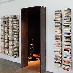 floating bookshelves next to door