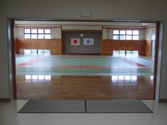 Aiki Dojo UK - Magnificent entrance to the dojo floor. Consider circular arch entrance with Inscription Martial Arts Gym, Karate School, Japanese Dojo, Hapkido, Gym Design, Metal Buildings, Entrance, Indoor Pools, Taekwondo