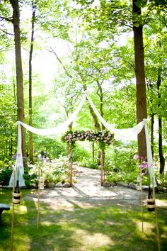 Drape fabric from tree to tree for wedding ceremony decor