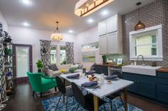 Bold colors in open plan living room, dining room, and kitchen. Fun, honeycomb tile in the kitchen.