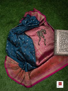 Midnight Blue Color Pure Katan Silk Banarasi Saree weaved in Zari Booti across the Body and Zari work on Maroon Pink Broad Border and Pallu. Blue Silk Saree, Silk Saree Kanchipuram, Wedding Silk Saree, Banarasi Sarees, Trendy Sarees, Stylish Sarees, Fancy Sarees, Cotton Saree Designs