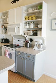 """Love the contrasting cabinet colors!!  """"Real World"""" Kitchen Makeover Inspiration   One Good Thing by Jillee"""