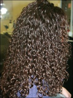 even, tight curl in this long perm style