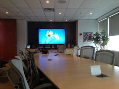 TV installed in boardroom for presentation inside of commercial building. Tv Wall Mount Bracket, Wall Mounted Tv, Tv Wall Mount Installation, Projector Ceiling Mount, Industrial Ceiling Fan, Best Projector, In Wall Speakers, Separating Rooms, Home Theater Design