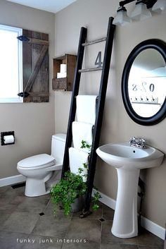 Funky Junk Interiors: Love everything about this bathroom, the rustic shutter, the toilet paper crate above the toilet, the ladder, and the oval mirror.  So simple yet so elegant.
