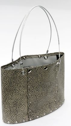 Hardwear By Renee (hardwearhandbags.com) - these bags are AMAZING!!!  I kind of want ALL of them....