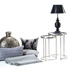 Bring a hint of NY glamour to your home, with a little help from Wysada. Keep colors classic, with sleek, lacquered adjustable stools in black from Pols Potten, paired with soft furnishings in muted shades of grey. From Wysada.com
