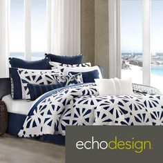 African Sun is a beautiful bed set brought to life with a bold sunburst pattern. The oversized comforter has a dark blue background to play up the bright white sunbursts.