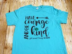 This is for ADULT SHORT SLEEVE Girl Scout shirts. To purchase youth size shirts, please visit my shop.  This is the perfect shirt for your Girl Scout Troop! They can wear this Have Courage and Be Kind shirt to sell girl scout cookies, to their troop meetings, on their girl scout camping trips, as well as just everyday. This is also a great gift for any girl scout troop leader, co-leader, girl scout volunteer, or even your own girl scout! These are done on adult unisex t-shirts. Shirts are…
