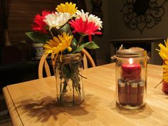 Mason jar with flowers & a mason jar with empty shot gun shells & candle. We hung these from shepherds hooks at the end of rows of hay. Also sat them on the stumps with the Firefighter boots.