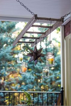 Outdoor patio ladder candle chandelier by Unskinny Boppy *Idea: Chain ladder to strong hooks in rafters. Wrap white lights around it. Wrap vined silk flowers around the light to hide wires. Hang plants from ladder rungs. Old Wooden Ladders, Wooden Ladder Decor, Rustic Ladder, Wooden Spools, Diy Pergola, Pergola Kits, Pergola Ideas, Diy Patio, Pergola Roof