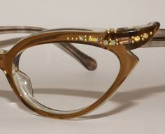 Womens cat eye glasses frames with no markings. Smokey gray color has owl or eyelash upper frames with rhinestone detailed corners. Matching temples have wire support inside. These are gently worn and are in very good condition. *Right eyebrow has one missing crystal*. Temples are wire reinforced. These have no lenses, so you are purchasing frames only. You will have to take these to a optical professional to get your own lenses put in.  4 1/2 hinge to hinge 5 1/2 across the top framework 1…