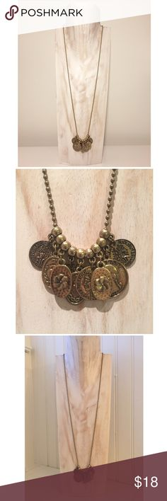 "Vintage 80s Antq Gold Replica Coin Charm Necklace Circa late 80s. Antique gold tone long charm necklace w/ imitation coins & tokens. Featuring novelty 1808 Republique Francaise ""coins"" embossed w/ Napoleon Bonaparte's profile, a replica of a 1966 American quarter, and tokens stamped w/a pansy floral design & a dual-sided charm w/a goodwill heart & figure on other side. Hanging coins/charms are hollow & lightweight. Ball chain w/ clasp enclosure. Overall adj length 29-1/4"" to 32-1/2"". Count…"
