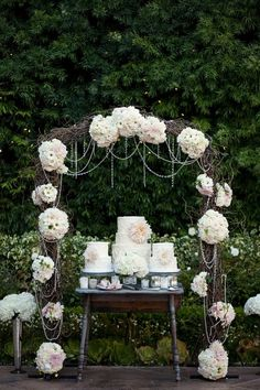 Rustic chic wedding cake display. Are you drooling yet? by tracey #pearls #flowers #white #pink