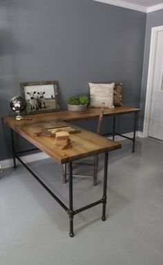Love the idea of reclaimed wood. Industrial aesthetic with metal pipe support.