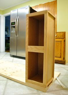 A tutorial on making a built in cabinet for a fridge - Build It In, Build It In Cabinets To Ceiling, Cabinets To Go, Refinish Kitchen Cabinets, Refrigerator Cabinet, Built In Refrigerator, Diy Kitchen Projects, Home Projects, Wooden Kitchen, Kitchen Decor