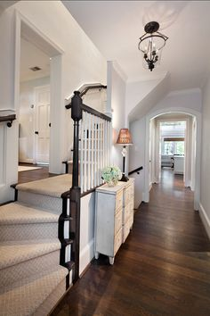 "A soothing color palette welcomes you as soon you open the door. Lighting is by ""Visual Comfort & Co."" Cape Cod Renovation Ideas"