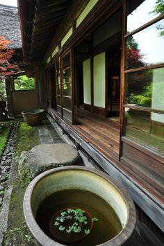 Hallway, sliding glass doors, rocks in the garden, moss.