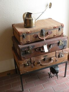old suitcases  and antique watering can