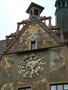 city hall-- astronomical clock--The Rathaus (Ulm, Germany) was built in 1370 as a warehouse & from 1419 has served as the town hall.  The ornate murals dating from the mid-16th century & the astronomical clock on the east gable dates from 1520
