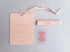 peach hang tag den røde tråd i packaging