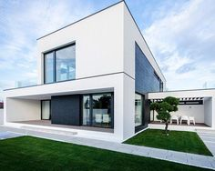 black and white C house by parasite studio in timisoara, romania