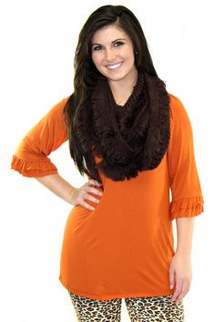 Solid black lightweight tunic with an adorable ruffled sleeve. (95% Rayon, 5% Spandex)