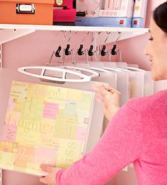 Scrapbook papers hanging from clothes hangers. Storage/organization tip. Love this idea from BHG.