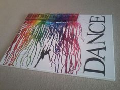 did it my self. cut and paste letters on a canvas. a figure if you choose. take blacks, whites, and browns out of a 64 pack of crayola crayons. hot glue them across the canvas. melt with a hair dryer. easier than it looks. it was my first time ever trying this for my friends birthday present, who is an amazing dancer. she absolutely loved it. :)