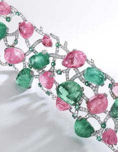 Emerald, pink sapphire and diamond bracelet, 'Sassi', Michele della Valle Of open work design, set with cabochon emeralds and pink sapphires, the links embellished with brilliant-cut diamonds and circular-cut emeralds, length approximately 180mm, signed Michele della Valle, numbered, case stamped Michele della Valle. #diamondbracelets