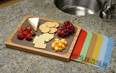 Shop for Seville Classics Bamboo Cutting Board with 7 Color-Coded Flexible Cutting Mat Set with Food Icons. Get free delivery On EVERYTHING* Overstock - Your Online Kitchen & Dining Shop! Best Cutting Board, Bamboo Cutting Board, Plastic Cutting Board, Cutting Boards, Bamboo Board, Wood Cutting, Cutting Board Storage, Chopping Boards, Plastic Mat