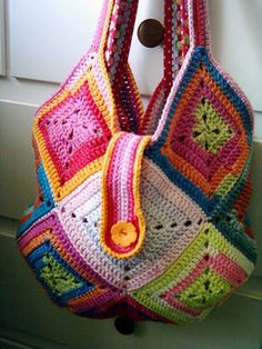DIY  turn granny crochets into handbag - not these colors, but I like the bag.