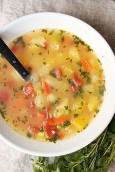Peruvian Really Good Vegetable Soup (Vegan) Acorn squash, carrot, tomato, brown rice, peas, corn, oregano, parsely, veg stock and lemon juice