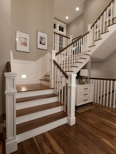 Like the square newel posts. This is similar to what we could achieve with the white risers and dark wood tread and handrail. I think that the simplicity of the balusters would make them less expensive.
