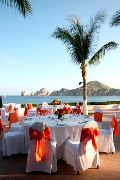 Orange and yellow wedding colors - so nice with the ocean background