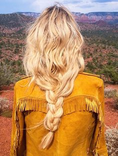 Loosely boho braided hair and modern hippie fringe jacket. FOLLOW https://www.pinterest.com/happygolicky/the-best-boho-chic-fashion-bohemian-jewelry-gypsy-/ for more Bohemain style ideas.