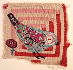 Unframed appliqued bird with embroidery on to vintage quit fragment