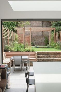Previously this house had a dark kitchen at the lower ground level and a large utility room that formed a barrier between house and… Terraced Backyard, Sloped Backyard, Sloped Garden, Backyard Patio Designs, Small Backyard Landscaping, Terrace Garden Design, Back Garden Design, Garden Seating, Small Patio Design