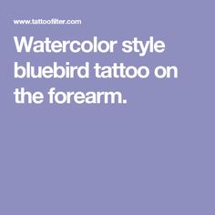 Watercolor style bluebird tattoo on the forearm.
