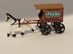 Chris Sturgess-Lief - horse drawn milk truck toy, handpainted and carved wood, purchased on ebay, 2016