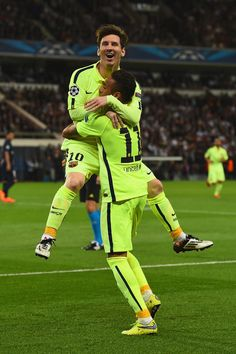 Neymar of Barcelona celebrates scoring the opening goal with Lionel Messi of Barcelona during the UEFA Champions League Quarter Final First Leg match between Paris Saint-Germain and FC Barcelona at Parc des Princes on April 15, 2015 in Paris, France.