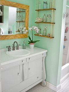 Removing inner walls and adding minty-green paint with vintage-style finishes revived this couple's single bathroom.