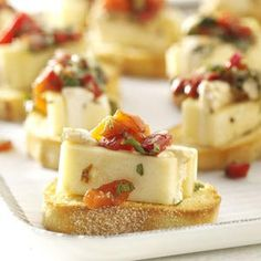 Marinated cheese!!! Made this for my Mary Kay Ladies Day...Yummo!!! The left over marinade and peppers can be used for dipping French bread!!!