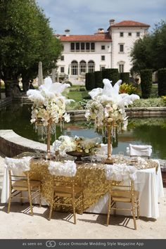 Great Gatsby-Golden candelabras dripping with crystals, Garden roses, gardenias, calla lilies, orchids and hydrangea topped with a spray of feathers. Great Gatsby Themed Wedding, Flapper Wedding, Chic Wedding, Our Wedding, Wedding Reception, Floral Centerpieces, Wedding Centerpieces, Wedding Decorations, Candelabra Centerpiece