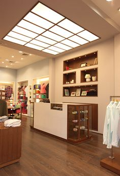 I chose this image because it is very modern. I love the horizontal and vertical lines that form the large, flat light fixture on the ceiling. The feeling the store gives is very warm also because of the pot lights and dark wood floors.