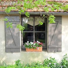 shutters, perhaps barn red to match the potting shed