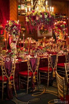 Stunning dramatic wedding decor with floral chandelier