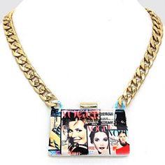 """• Style No : 241819 %0D%0A• Color : Gold / Pink / Blue / White %0D%0A• Necklace Size : 20"""" + 3"""" L %0D%0A• Charm Size : 3"""" X 2"""" %0D%0A• Ceramic-Like Heavy Clutch Charm / Resin Enamel / Vogue Magazine %0D%0A• Magazine Clutch Charm Necklace %0D%0A• Material : Lead, nickel, cadmium compliant"""