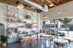 A kids' play area is included in the Big and Tiny co-working space in Santa Monica so that its members can bring their children to work. Santa Monica, Popcorn Ceiling, Kids Play Area, Co Working, Coworking Space, Retail Space, Kid Spaces, Elle Decor, Retail Design