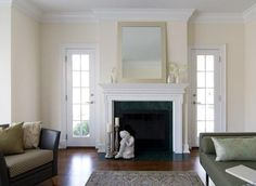 Benjamin Moore's Linen White...shall be the hallway color. White Dove is the trim. Love the white/white look for a dark, narrow space.